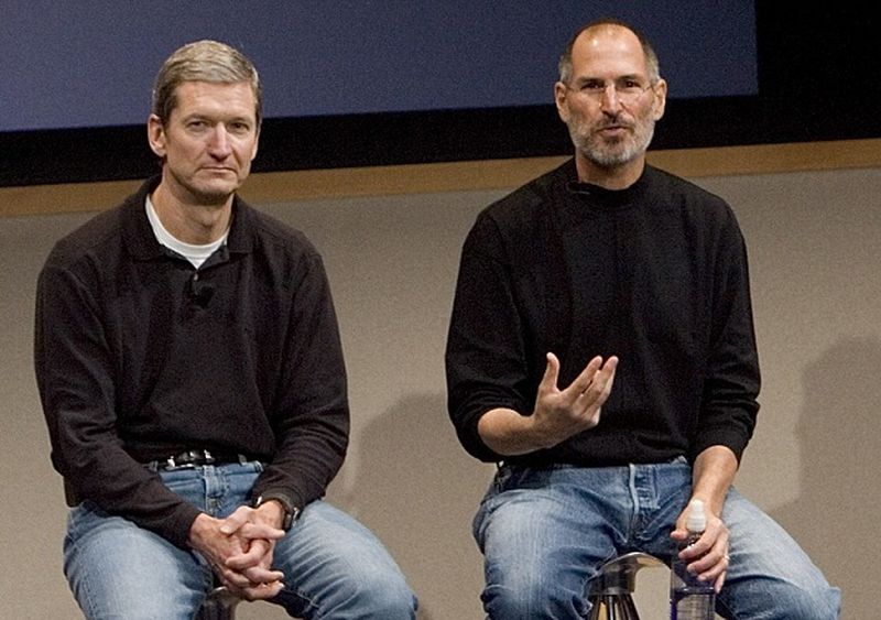 Steve Jobs and Tim Cook sitting side by side