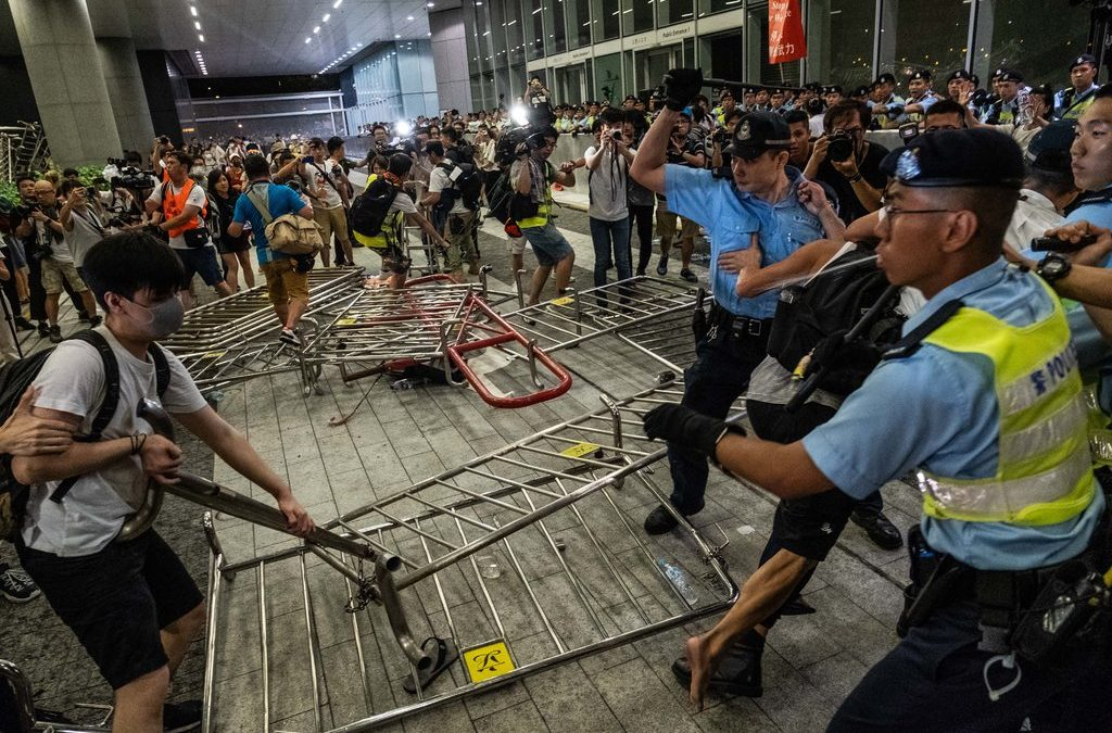 How are the Hong Kong protests taking a toll on the people?